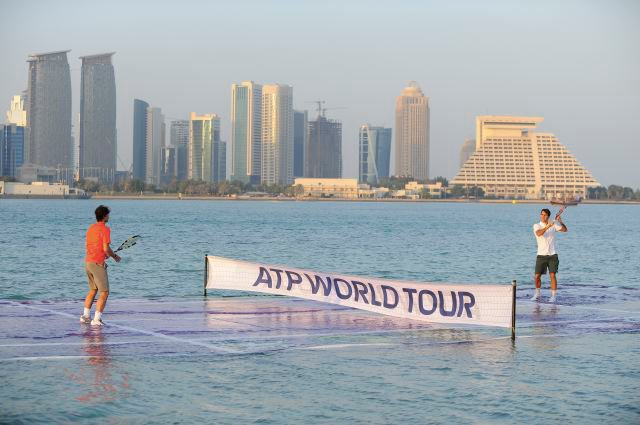 Nadal and Federer playing tennis on a submerged court on Doha Bay (Photo: Wired)