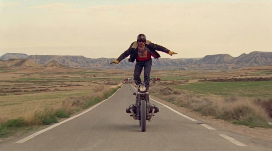 Standing on motorbike